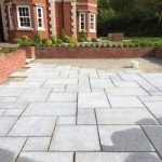 Patio blocks being assembled